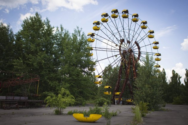 A Ferris wheel at a playground in the deserted town of Pripyat, Ukraine, some 3 kilometers (1.86 miles) from the Chernobyl nuclear plant. Chernobyl and Fukushima are some 5,000 miles apart but have much in common. The towns nearest to each of these stricken nuclear power stations, in Ukraine and Japan, whose disasters struck 25 years apart, already reveal eerie similarities. (AP Photo/Sergey Ponomarev)