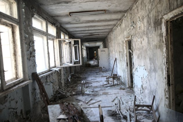 An abandoned middle school, part of the contaminated area surrounding the Chernobyl Nuclear Power Plant, in Pripyat, Ukraine. The ghost town which once had a population of about 50,000 people, was given a few hours to evacuate in April 1986 as radiation streamed into populated areas after an explosion at the reactor. (Joseph Sywenkyj/The New York Times)