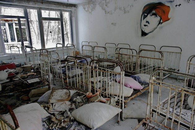 The remnants of beds are seen in an abandoned in a pre school in the deserted town of Pripyat on January 25, 2006 in Chernobyl, Ukraine. Prypyat and the surrounding area will not be safe for human habitation for several centuries. Scientists estimate that the most dangerous radioactive elements will take up to 900 years to decay sufficiently to render the area safe. (Photo by Daniel Berehulak/Getty Images)