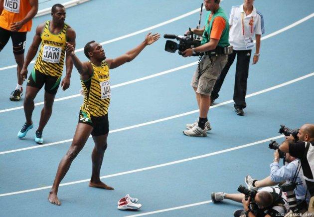 Bolt, que mide 1,96 metros, calza un 48,5, según recogía el año pasado El País. AFP PHOTO / LOIC VENANCE