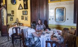Tourists enjoy La Guarida private restaurant